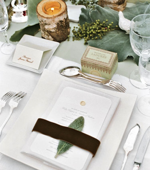 white and green florals down the length of the reception dining table