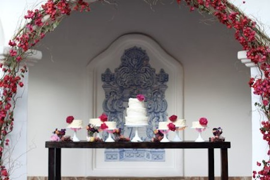 the gorgeous display of rustic mini cakes alongside the wedding cake